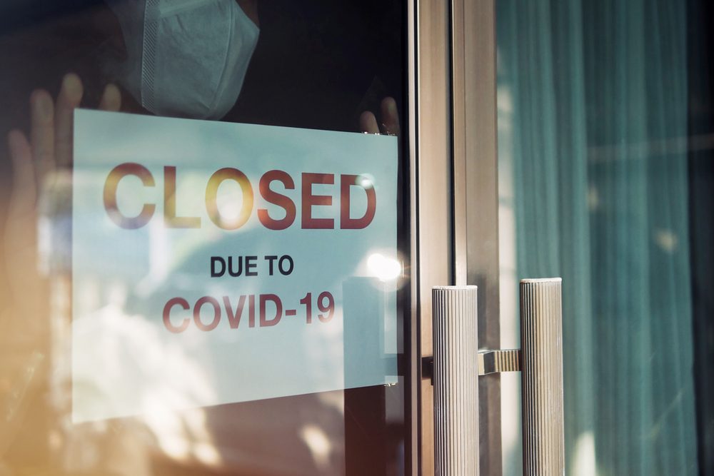 Business sign stating 'closed due to COVID-19'