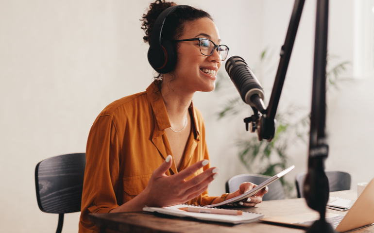 Woman recording podcast with microphone