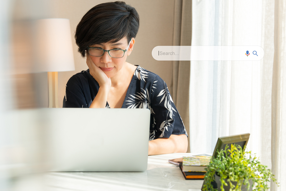 Woman doing a Google search on her laptop